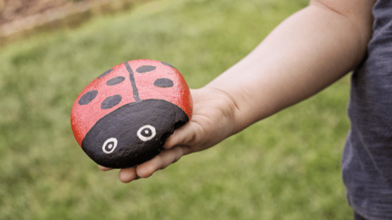 stone painting of a lady bird  arts and crafts for kids henn at home